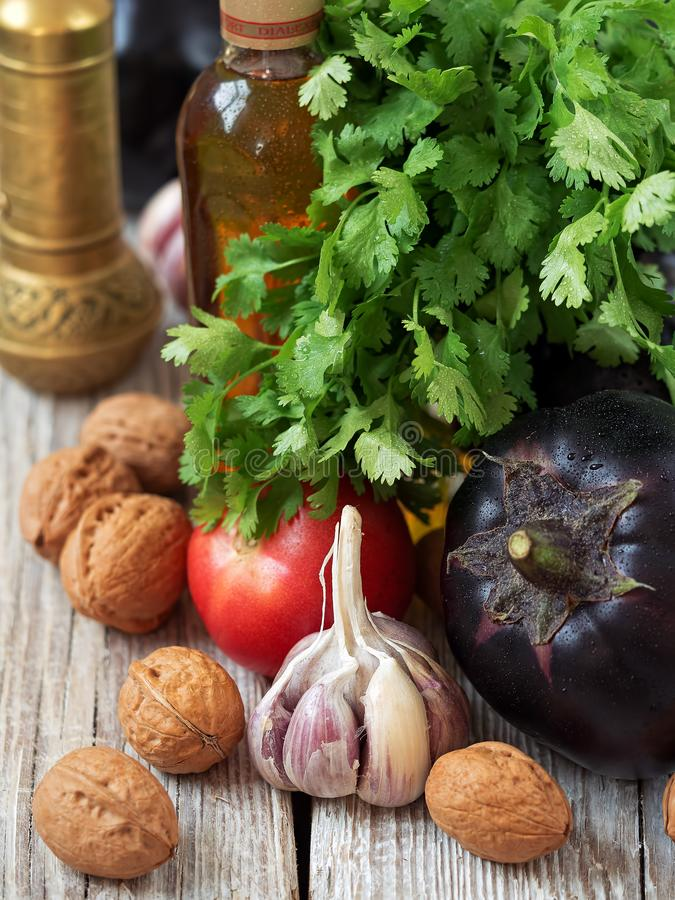 Fresh vegetables, herbs, spices are located on a wooden vintage surface. Procurement for dishes of Caucasian cuisine. Close-up. Fresh vegetables, herbs, spices stock photo