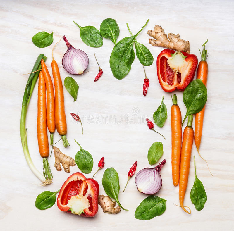 Fresh vegetables ingredients for cooking , composing on white wooden background, top view, frame. Healthy food stock photos