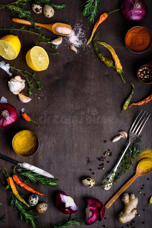 Fresh vegetables and ingredients for cooking on wooden background, vegetarian concept stock image