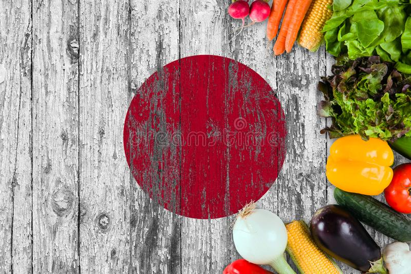 Fresh vegetables from Japan on table. Cooking concept on wooden flag background stock image