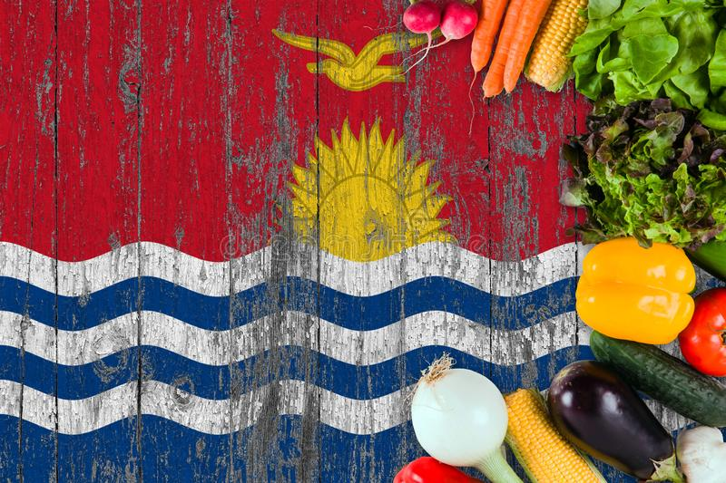 Fresh vegetables from Kiribati on table. Cooking concept on wooden flag background.  stock photos