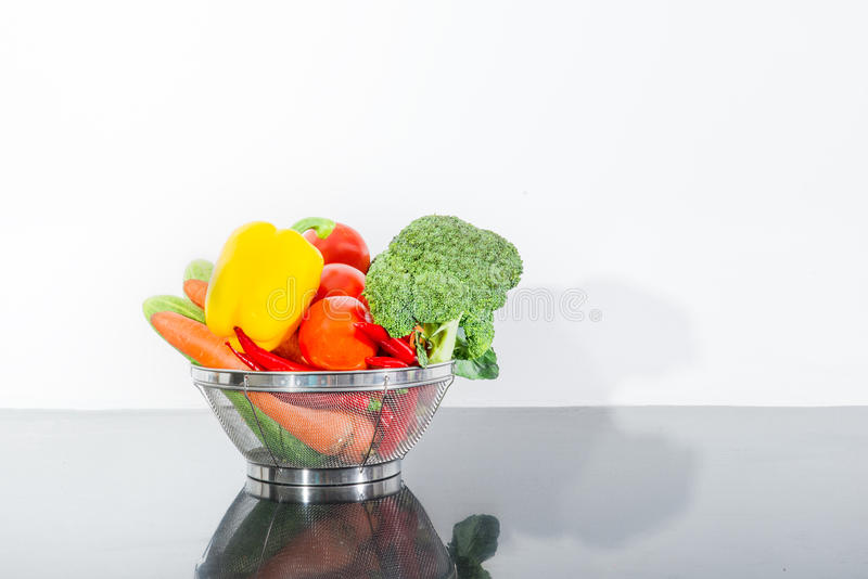 Fresh vegetables and knife on cutting board on kitchen counter stock images