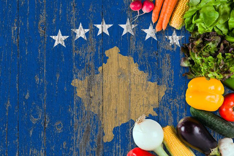 Fresh vegetables from Kosovo on table. Cooking concept on wooden flag background stock image
