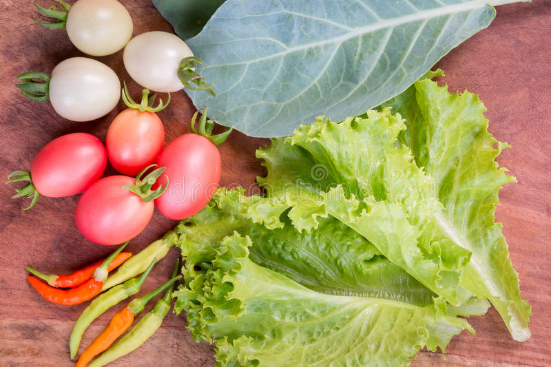 Fresh vegetables, lettuce, tomato, chinese kale and chili. royalty free stock images