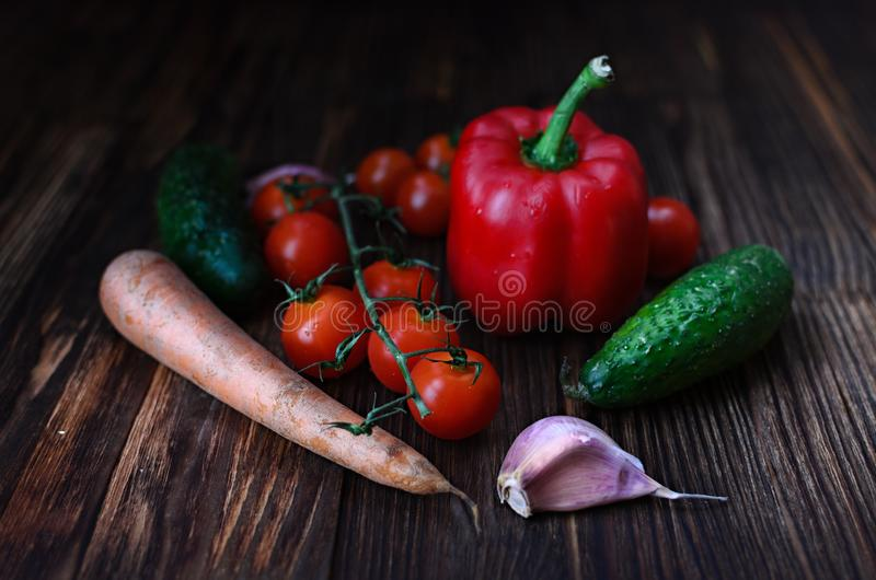 Fresh vegetables lie on a wooden table, still life of vegetables in a rustic style, vegetarian food royalty free stock photo