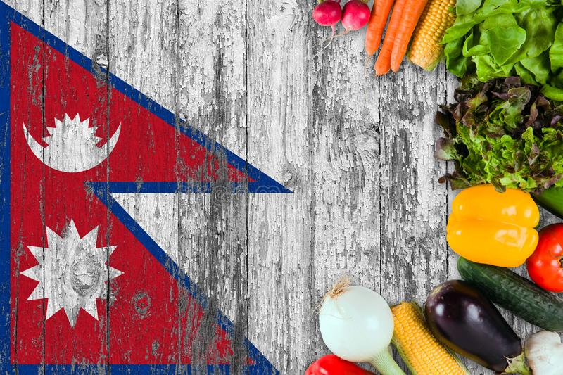 Fresh vegetables from Nepal on table. Cooking concept on wooden flag background royalty free stock photography