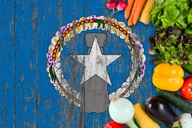 Fresh vegetables from Northern Mariana Islands on table. Cooking concept on wooden flag background stock image
