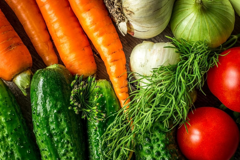 Fresh vegetables on the old board. Closeup royalty free stock image