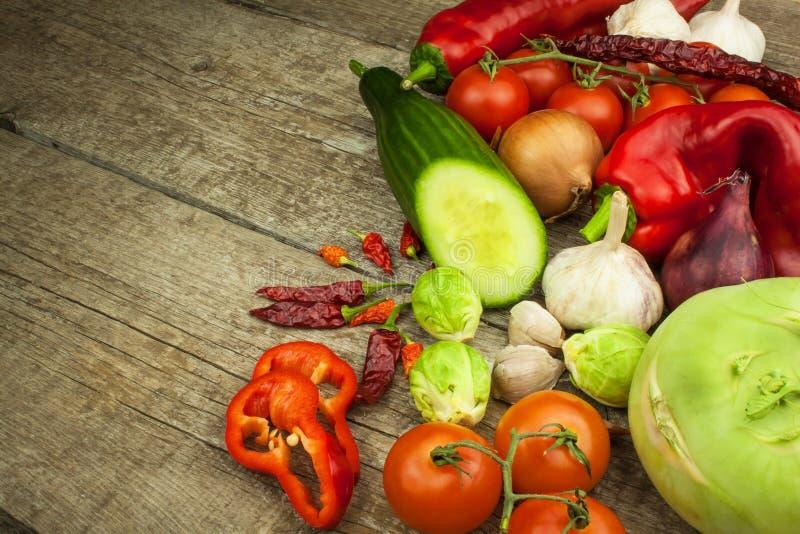 Fresh vegetables on an old wooden table. Preparing vegetarian food. Diet Food. Sales of vegetables. Fresh vegetables on an old wooden table. Preparing stock photos