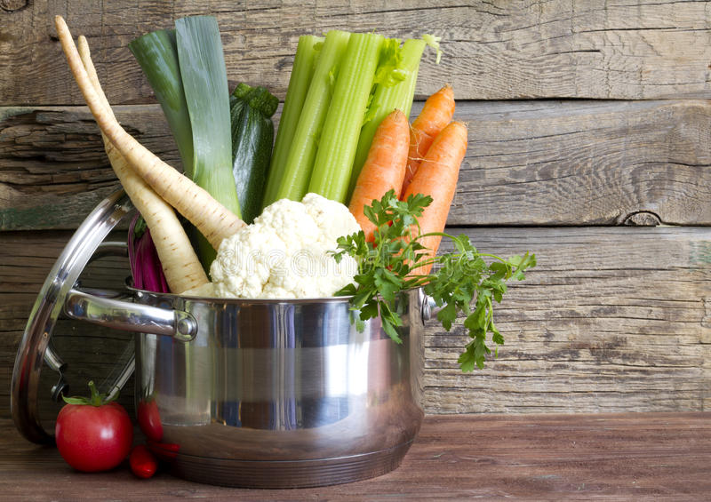 Fresh vegetables in the pot on vintage boards royalty free stock images