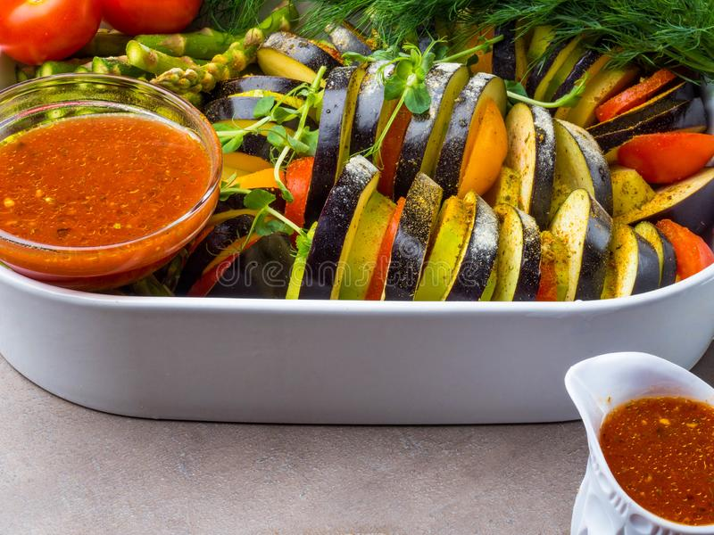 Fresh vegetables Ratatouille - traditional French Provencal vegetable dish cooked in oven. Diet vegetarian vegan food. Ratatouille - traditional French Provencal stock photos
