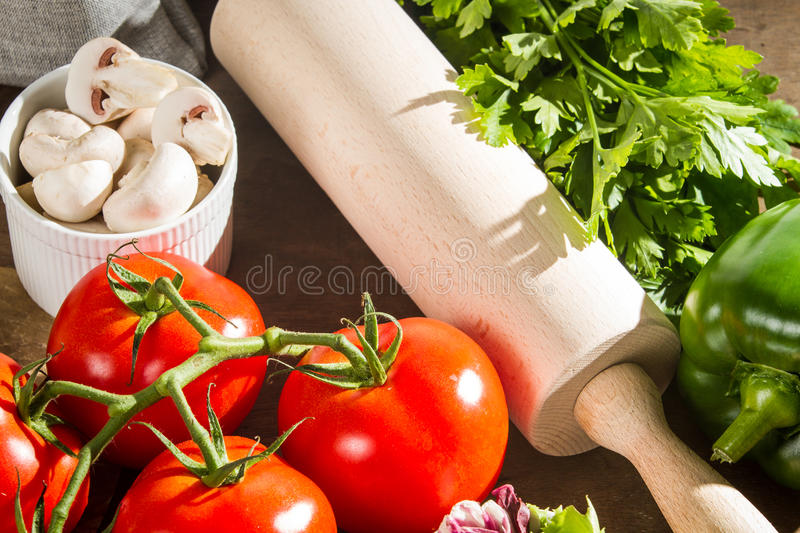 Fresh vegetables and rolling pin royalty free stock images