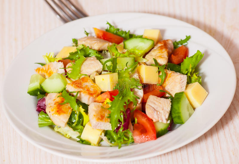 Fresh vegetables salad with chicken and cheese stock photo