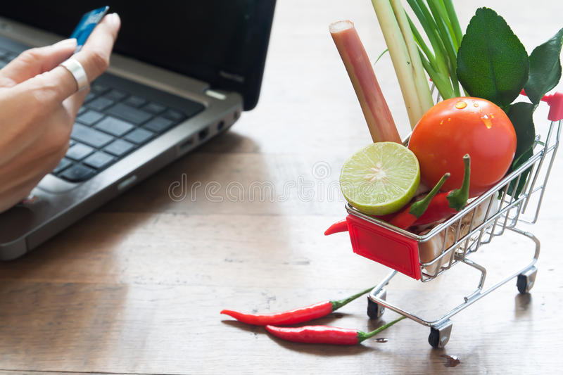 Fresh vegetables in shopping cart, Online shopping at home. Concept stock photo