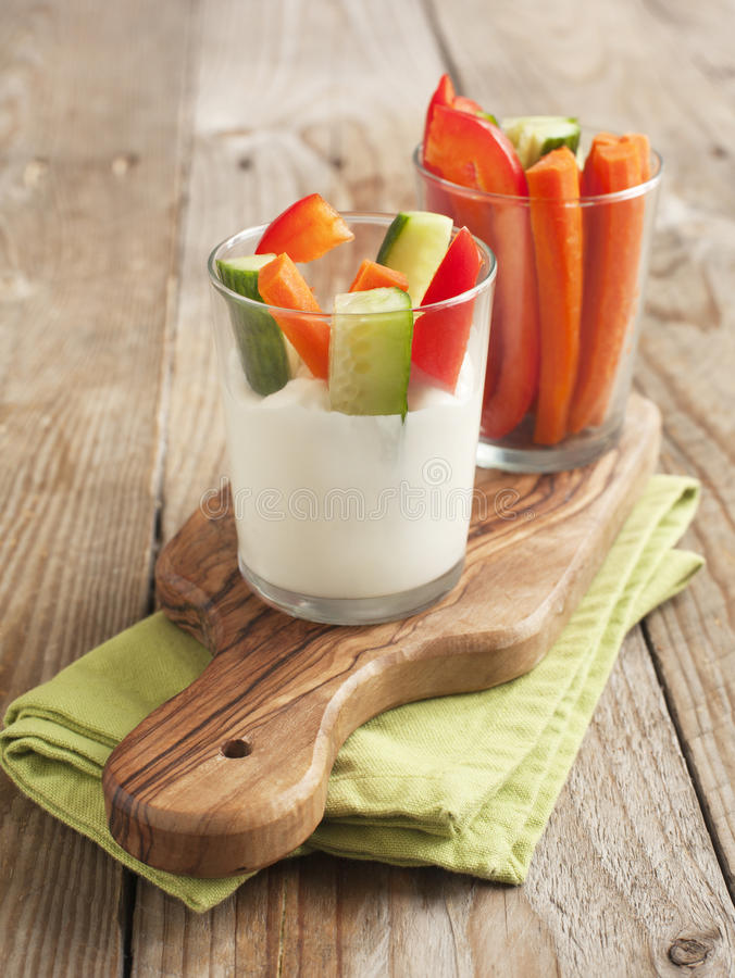 Fresh vegetables snack and yogurt cheese dip. Selective focus royalty free stock photos