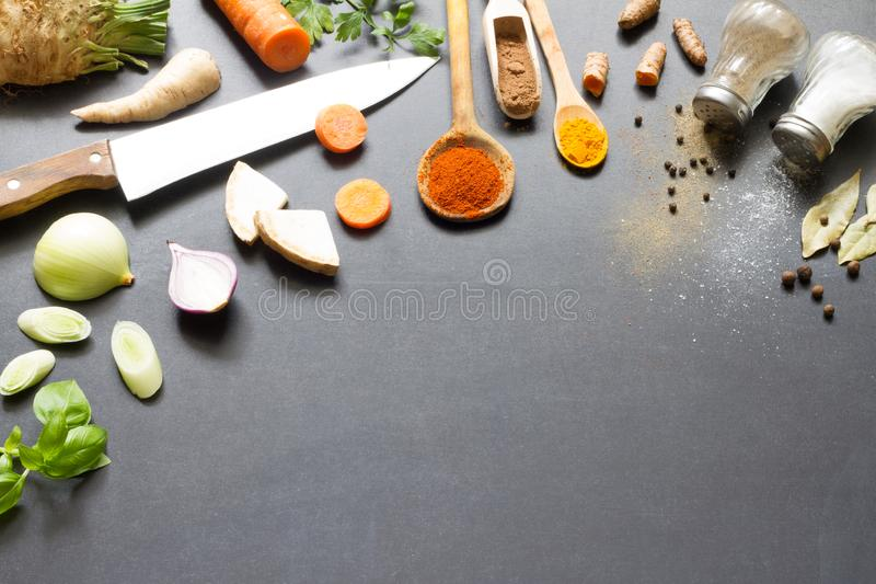 Fresh vegetables spices and food ingredients on blackboard background abstract concept royalty free stock image