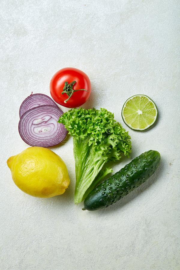 Fresh vegetables still life. Veges lined up on a white background, top view, close-up, selective focus, copy space. stock photography