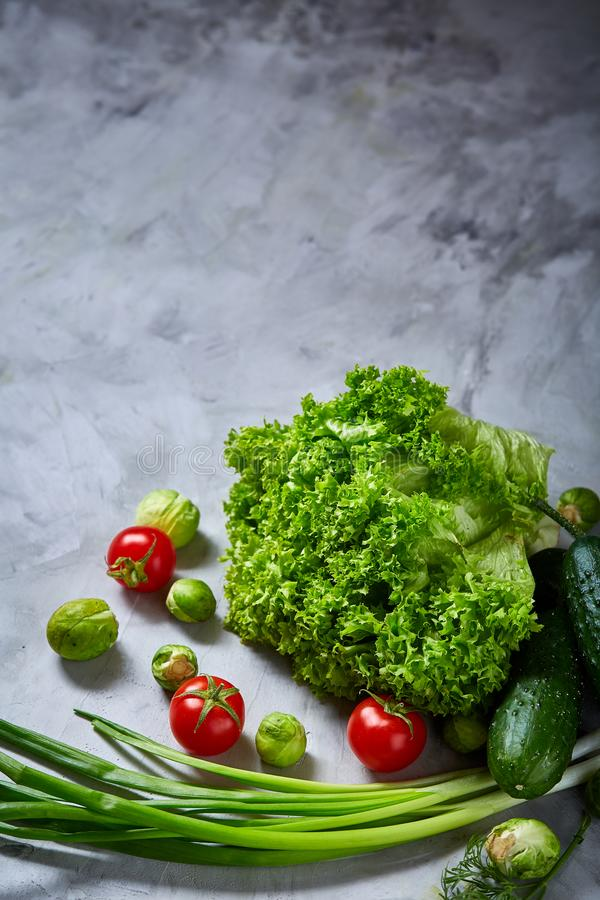 Fresh vegetables still life over white textured background, close-up, flat lay. royalty free stock photo
