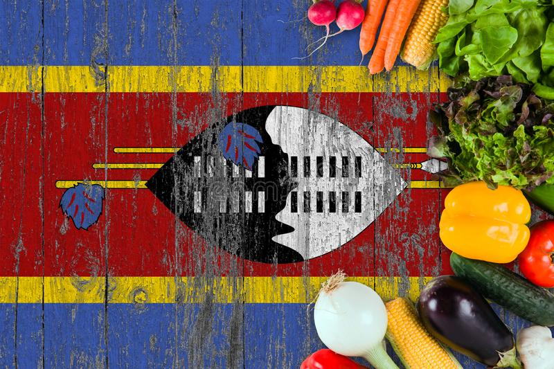 Fresh vegetables from Swaziland on table. Cooking concept on wooden flag background stock image