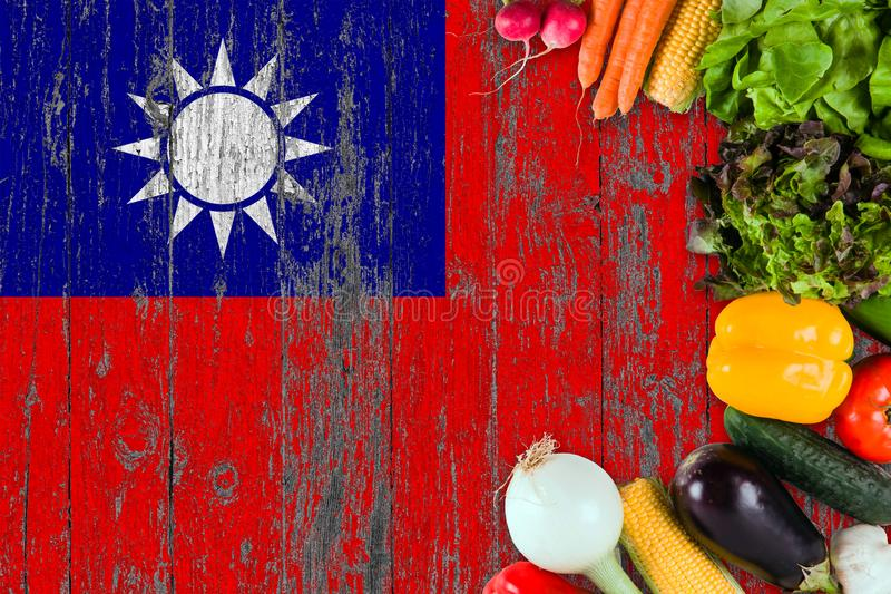 Fresh vegetables from Taiwan on table. Cooking concept on wooden flag background stock image