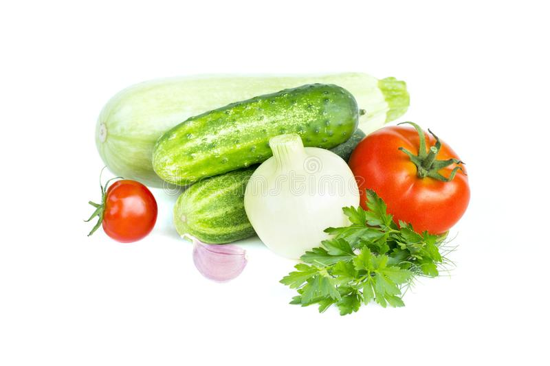 Fresh vegetables. Tomatoes, onion, zucchini, cucumber, garlic, parsley, food ingredients, isolated on white royalty free stock photos