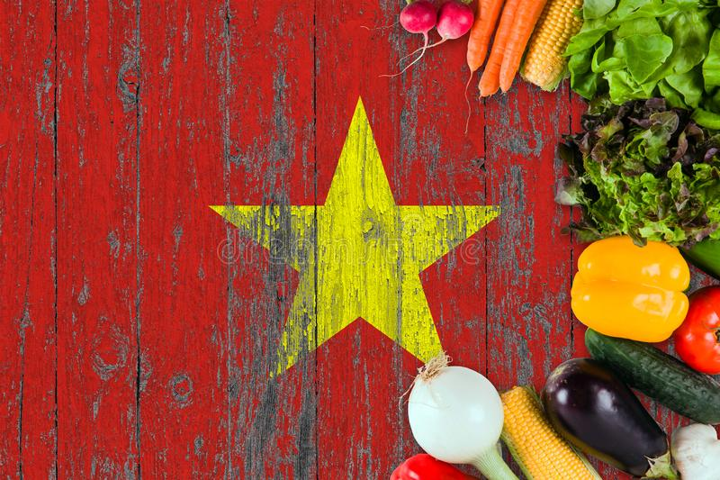 Fresh vegetables from Vietnam on table. Cooking concept on wooden flag background royalty free stock photo