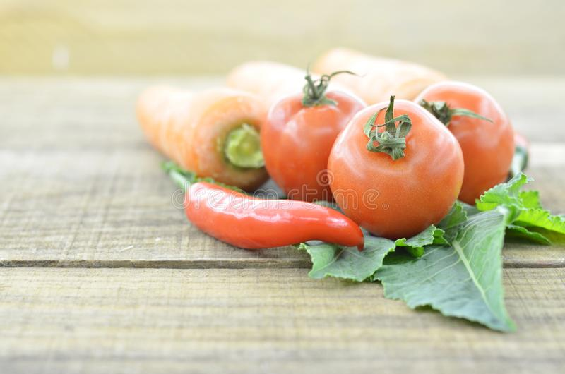 Collection fresh vegetables on wooden background stock photography