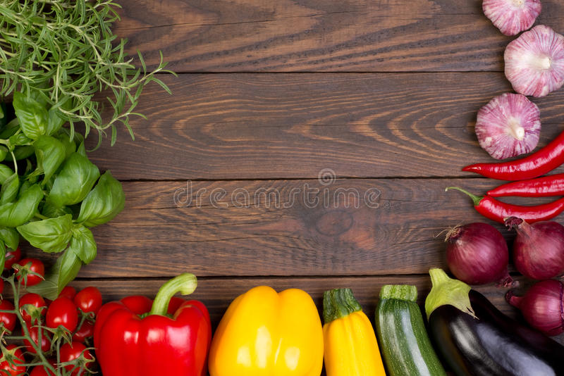 Fresh vegetables on wooden background royalty free stock photo