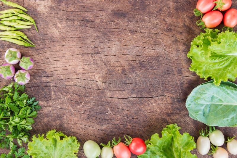 Fresh vegetables on wooden background. stock images