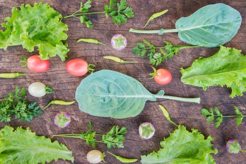 Fresh vegetables on wooden background. stock image