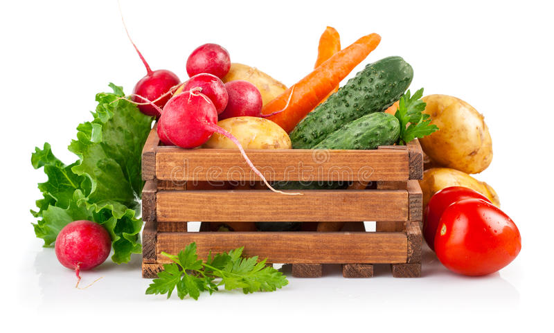 Fresh vegetables in wooden box royalty free stock photography