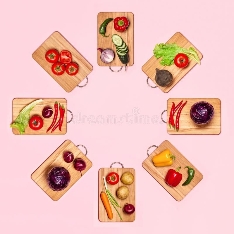 Fresh vegetables on wooden chopping boards stock photography