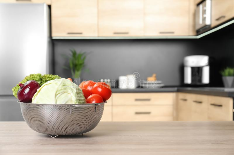 Fresh vegetables on wooden table in kitchen. royalty free stock images
