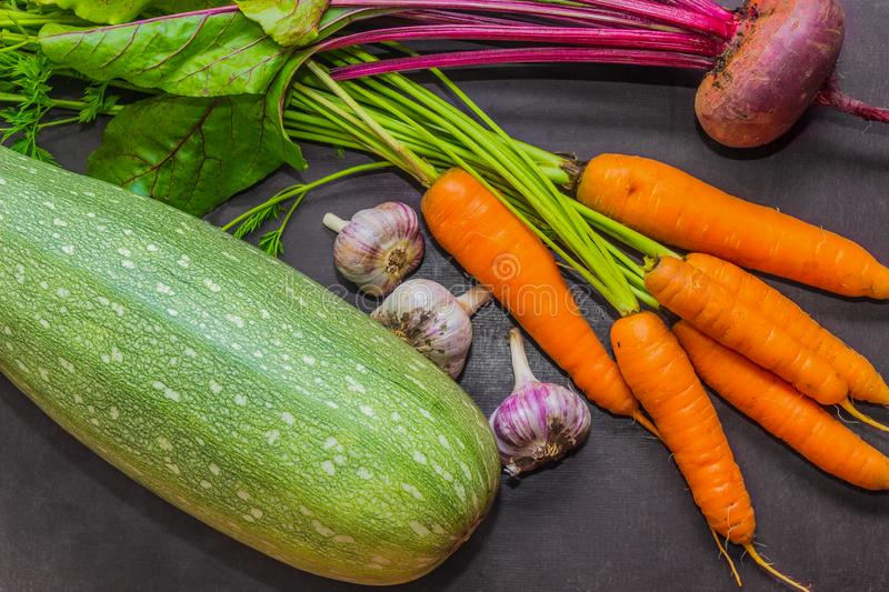 Fresh vegetables. Zucchini, carrots, garlic and beets on the table. Harvest. royalty free stock image