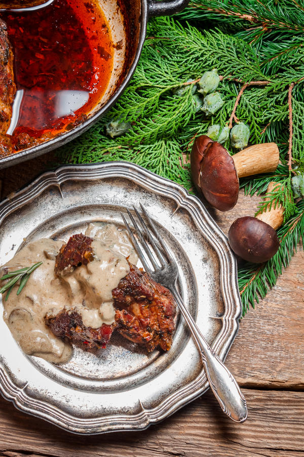 Fresh venison served with wild mushroom sauce stock images