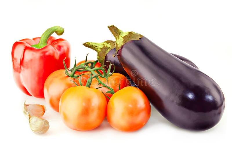 Fresh vitamin background with aubergine. Fresh vitamin background with garlic and aubergine over white royalty free stock photos