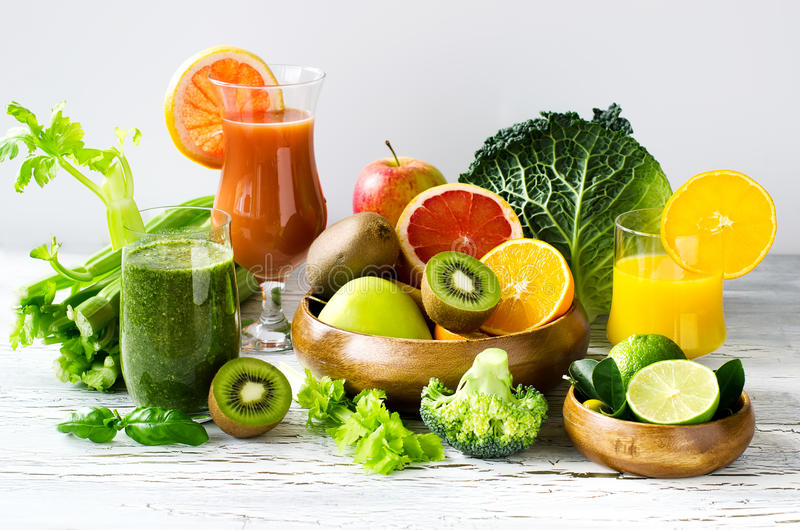 Fresh vitamins, citrus juice and smoothie with ingredients horiz. Fresh healthy detox smoothie and juice with fruits and vegetables royalty free stock photos