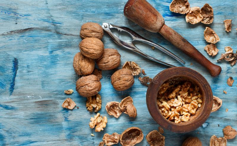 Image result for walnutts on blue wooden table