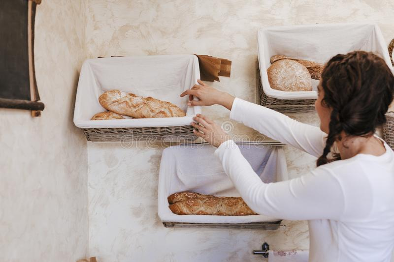 Fresh and warm. close up woman hand holding fresh and warm bread just from the oven. Bakery concept stock images