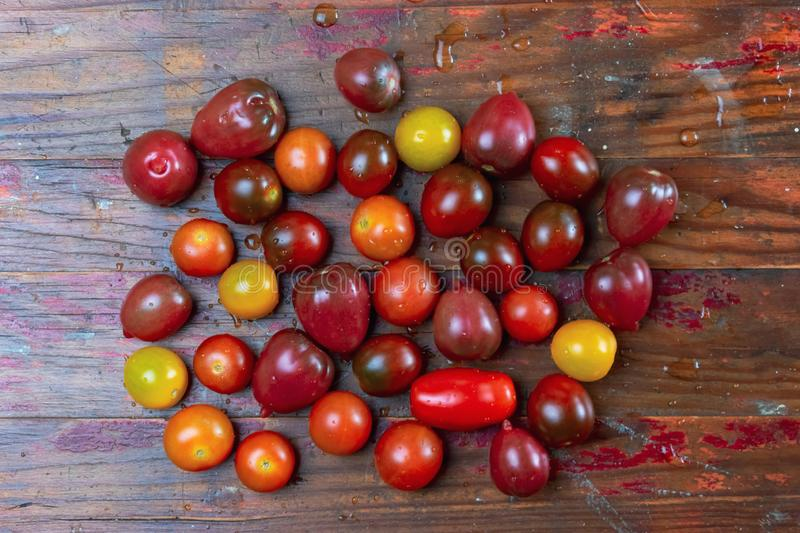 Fresh washed heirloom cherry tomatoes on wood background royalty free stock photos