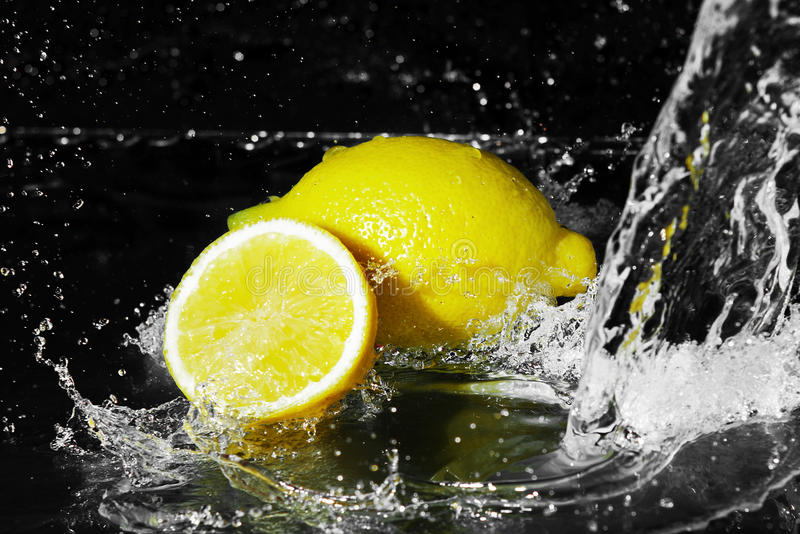 Download Fresh Water Drops On Lemon On Black Royalty Free Stock Image - Image: 27469816