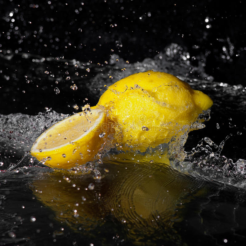 Fresh Water Drops On Lemon On Black Stock Photography