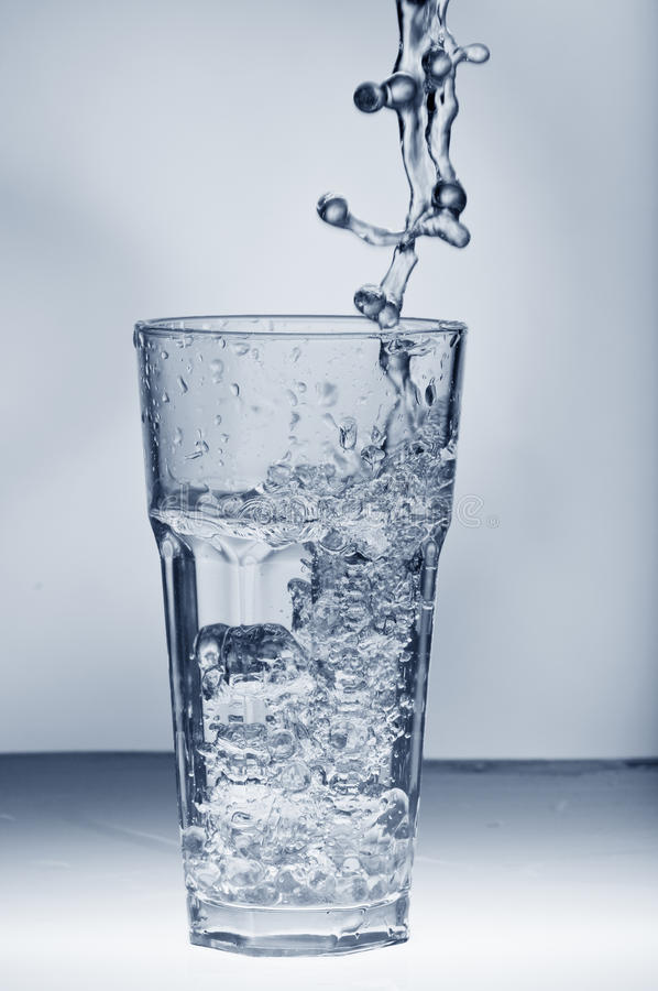 Download Fresh Water Splashing Out Of A Glass With Ice Stock Photo - Image: 18003988