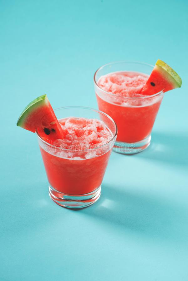 Fresh watermelon juice in the glass.Selective focus on the front. Glass stock images