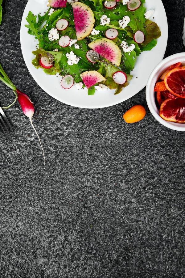 Fresh Watermelon Radish salad. Vegan, vegetarian, clean eating, dieting, food concept royalty free stock photography