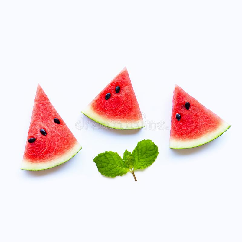 Fresh watermelon slices with mint leaves on white background stock photo