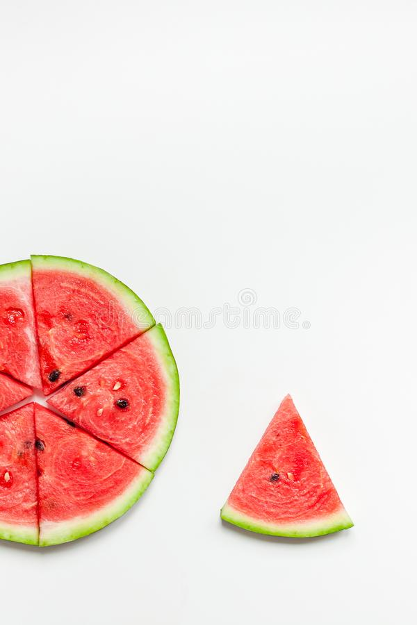 Fresh watermelon slices on white background. Creative scandinavian style flat lay top view of fresh watermelon slices on white table background copy space stock image