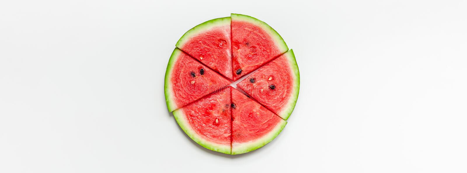 Fresh watermelon slices on white background. Creative scandinavian style flat lay top view of fresh watermelon slices on white table background copy space royalty free stock photo