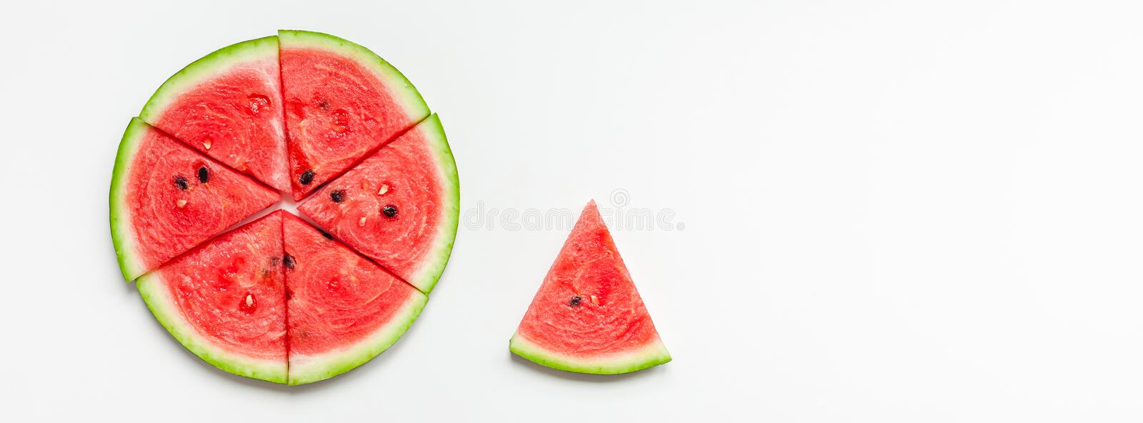 Fresh watermelon slices on white background. Creative scandinavian style flat lay top view of fresh watermelon slices on white table background copy space stock photography