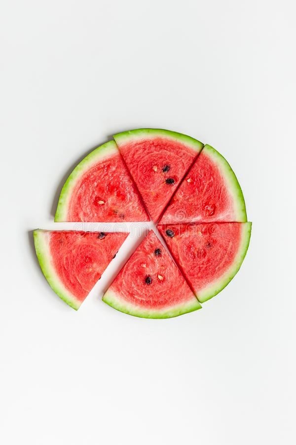 Fresh watermelon slices on white background. Creative scandinavian style flat lay top view of fresh watermelon slices on white table background copy space stock images
